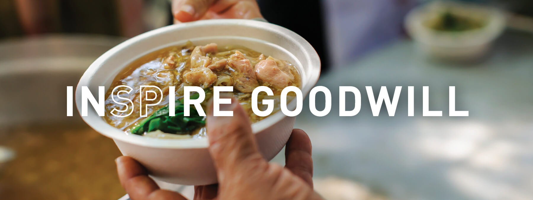 INSPIRE goodwill - giving food to someone
